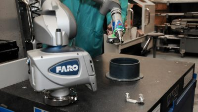 man using FARO metrology equipment